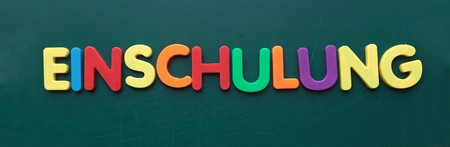 enrollment: The german term for enrollment in colorful letters on a blackboard.
