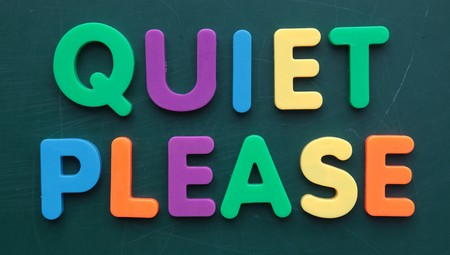noiseless: The term quiet please in colorful letters on a blackboard.