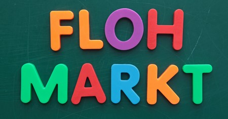 the term: The german term for flea market in colorful letters on a blackboard.