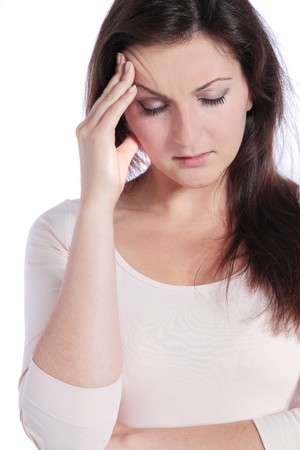 Attractive young woman suffering from headache. All on white background. Stock Photo - 7864860