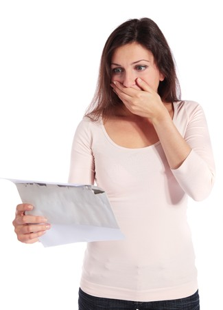 shocking: Attractive young woman getting shocking news. All isolated on white background.