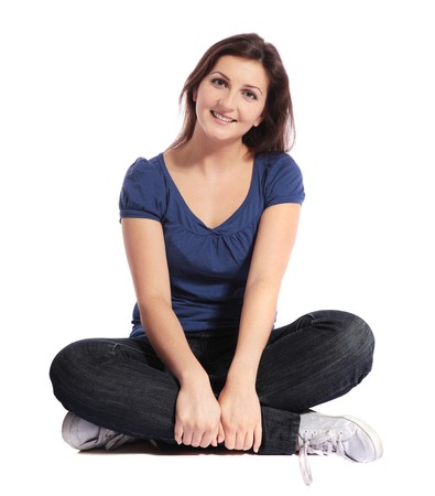 Attractive young woman sitting cross-legged Stock Photo - 7864928