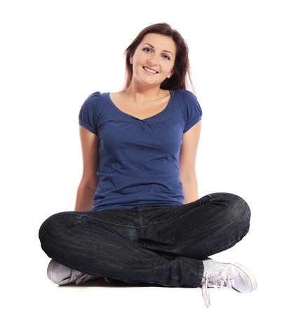 Attractive young woman sitting cross-legged Stock Photo - 7864929