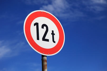 tons: Road sign prohibits trespassing vehicles heavier than 12 tons.