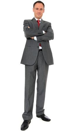 authoritative: Authoritative businessman. All on white background.  Stock Photo