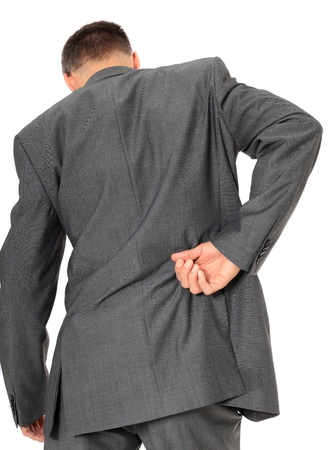 back ache: Businessman suffering from backache. All on white background.