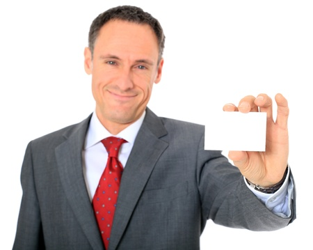 Attractive businessman holding business card. All on white background.  photo
