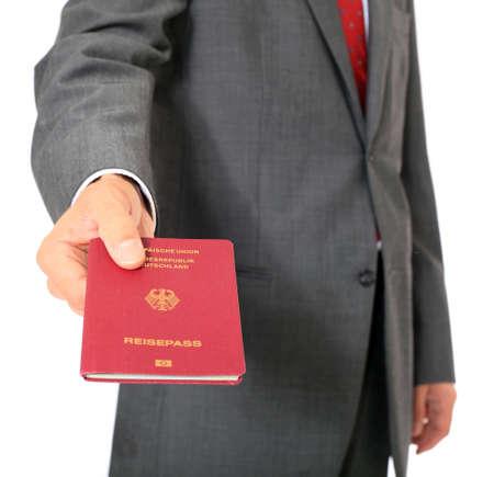 visa: Businessman showing his german passport. All on white background.  Stock Photo