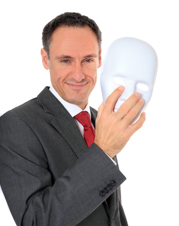 anonym: Attractive businessman reveals his face behind a mask. All on white background.