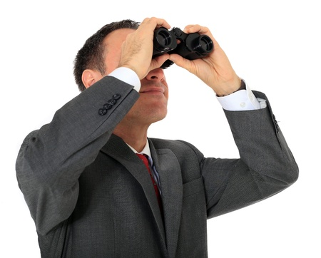 Attractive businessman using spyglass. All on white background. photo