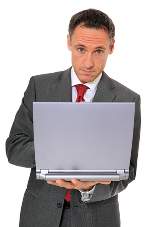 Attractive businessman using notebook computer. All on white background.  photo