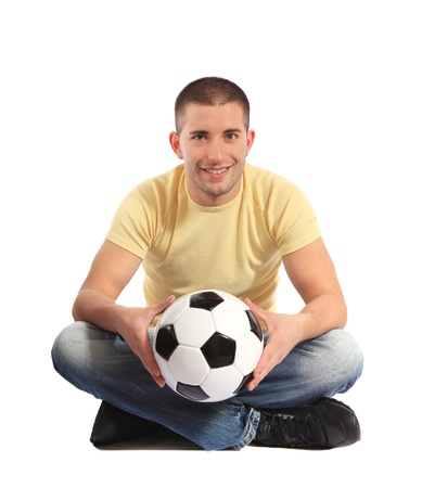 Attractive young man holding a soccer ball. All on white background  Stock Photo - 8488218