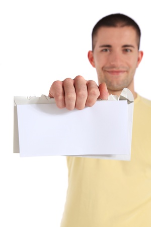 Attractive young man getting good news. Selective focus on hand/letter in foreground. All on white background Stock Photo - 8488214