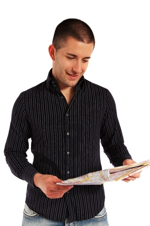 Attractive young man looking at a map. All isolated on white background.  photo