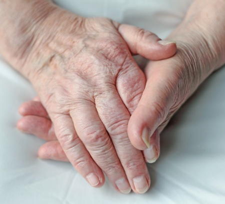 Old wrinkled hands of an elderly person.