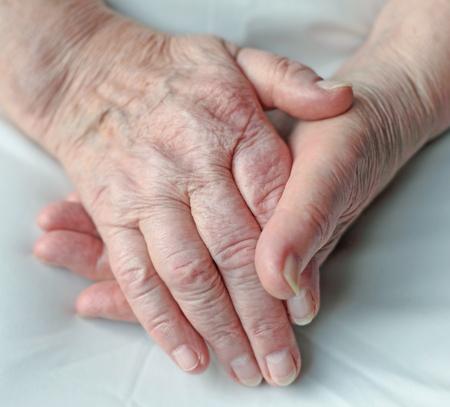 senior home: Old wrinkled hands of an elderly person.