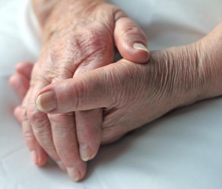 geriatrics: Old wrinkled hands of an elderly person.