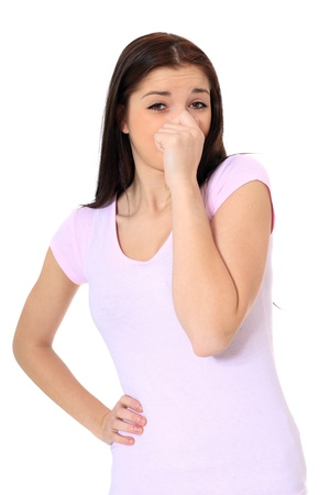 Attractive teenage girl smells something. All on white background. Stock Photo - 8680663