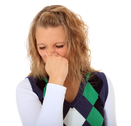 Attractive young woman sneezing. All on white background. Stock Photo - 8467066