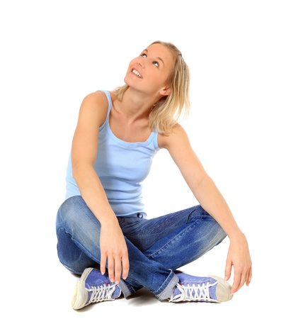 scandinavian people: Attractive scandinavian girl sitting on floor. All on white background.  Stock Photo