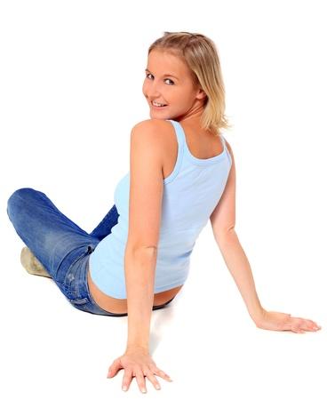 Attractive scandinavian girl sitting on floor. All on white background. Stock Photo - 8514838