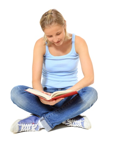 indian style sitting: Attractive young scandinavian woman reading a book. All on white background.