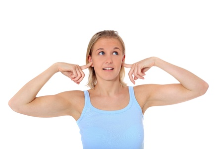 Attractive young scandinavian woman shutting her ears. All on white background.  photo