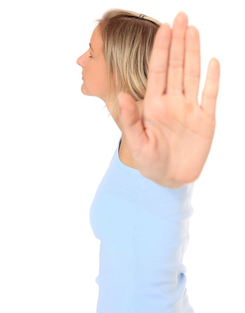 Attractive young scandinavian woman with repelling gesture. All on white background.