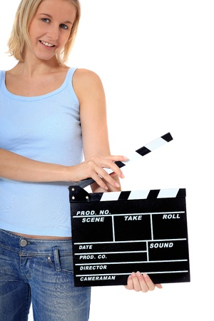 Attractive young scandinavian woman holding clapperboard. All on white background. photo