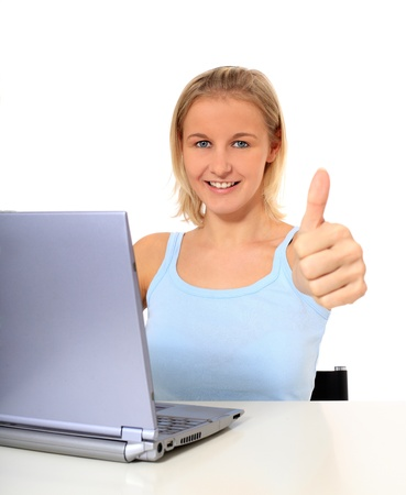 Attractive young scandinavian woman using notebook computer. All on white background. Stock Photo - 8514950