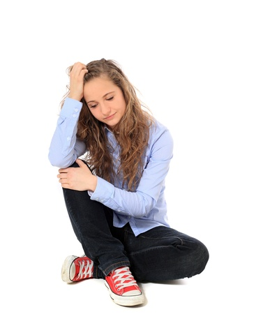 Desperate young girl. All on white background. Stock Photo - 8547532