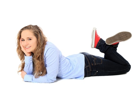 ground floor: Attractive young girl lying on the floor. All on white background.