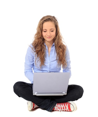 bonny: Attractive young girl using notebook computer. All on white background.  Stock Photo