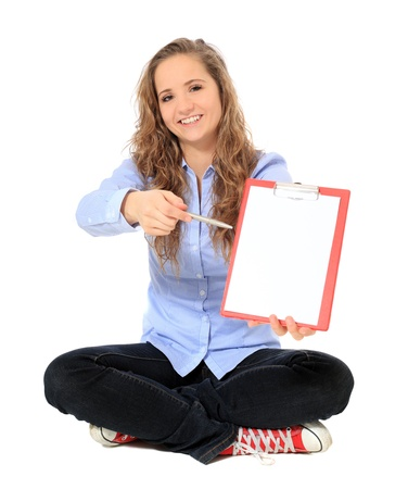 bonny: Attractive young girl pointing with pen on clipboard. All on white background.