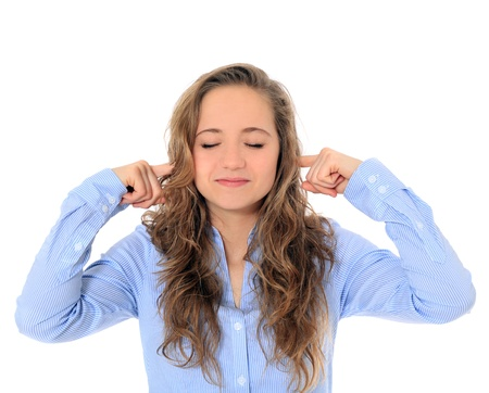 Fall on deaf ears of an attractive young girl . All on white background.  photo