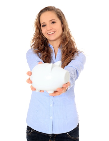 Portrait of an attractive young girl holding her piggy bank. All on white background.  Stock Photo - 8508469