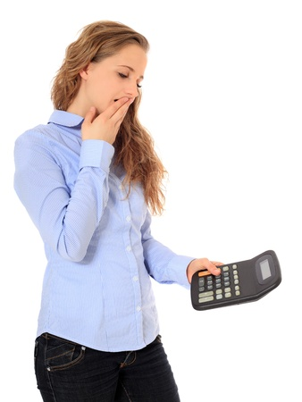 Portrait of a shocked young girl after crunching numbers. All on white background.  Stock Photo - 8529892