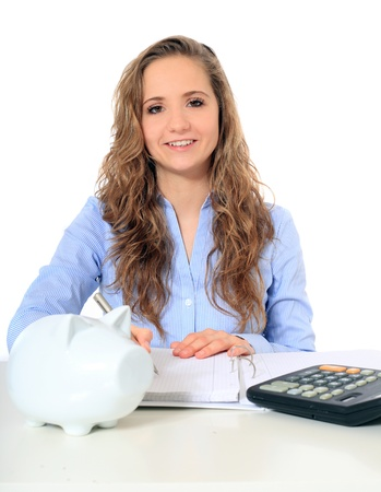 Portrait of an attractive young girl doing her budgeting. All on white background.  photo