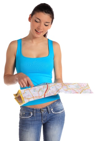 portrait orientation: Attractive young woman looking at a map. All on white background.  Stock Photo