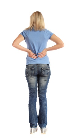 back ache: Back view of an attractive young woman suffering from backache. All on white background.  Stock Photo