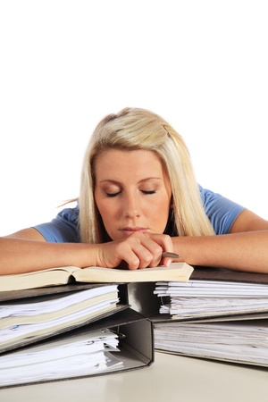 Attractive young student taking nap on her documents. All on white background.  photo