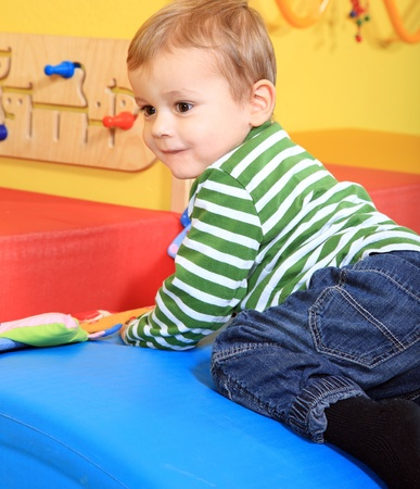 Cute caucasian toddler having fun in kindergarten.  Stock Photo - 8565105