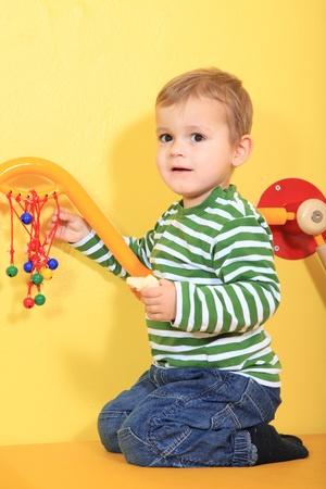 Cute european toddler in kindergarten.  photo