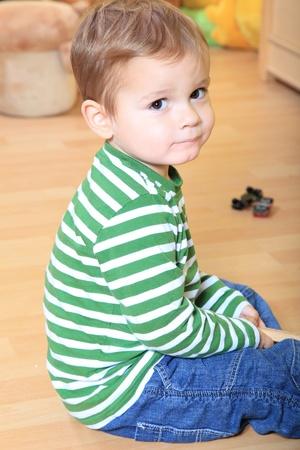 infancy: Cute caucasian toddler in kindergarten.