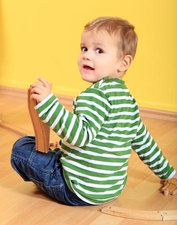 Cute european toddler playing in kindergarten.  photo