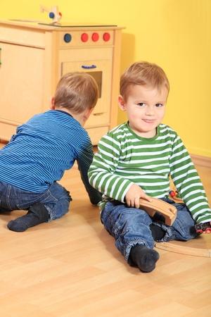 Cute caucasian toddlers playing fun in kindergarten.  photo