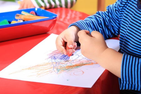 Cute caucasian toddler drawing a picture in kindergarten. Stock Photo - 8565184
