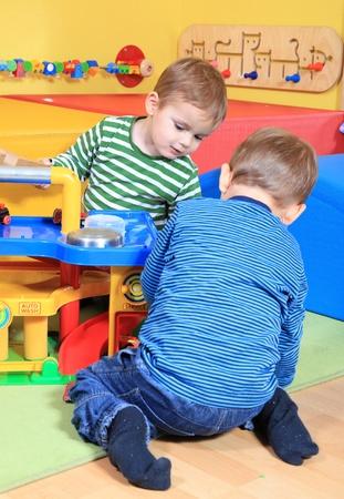 Cute caucasian toddler in kindergarten.  photo