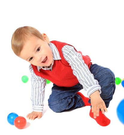 clowning: Cute caucasian toddler clowning around. All isolated on white background.