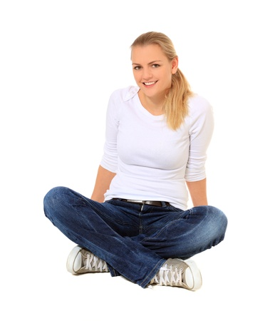 indian style sitting: Attractive blonde woman. All on white background.